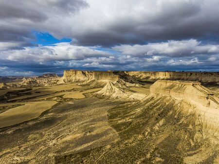Aerial view of Bardenas Reales semi-desert natural region at sunset in southeast Navarre, Spain