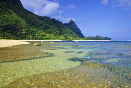 Beautiful Tunnels Beach is located on the north shore of Kauai, Hawaii and is a very popular snorkeling and diving destination. Stock Photo