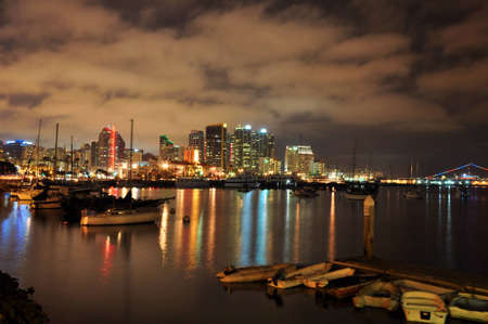 Nighttime view of the San Diego, California skyline and surrounding harbor. Stock fotó