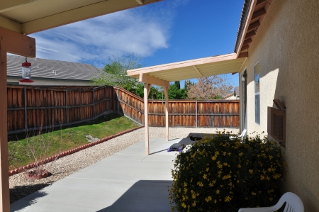View of a backyard covered patio at a tract house in southern California