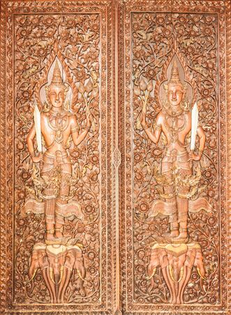 Thai Style Carving on the Temple Door  photo