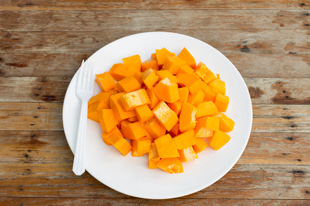 Papaya fruit in dish on Wooden table photo