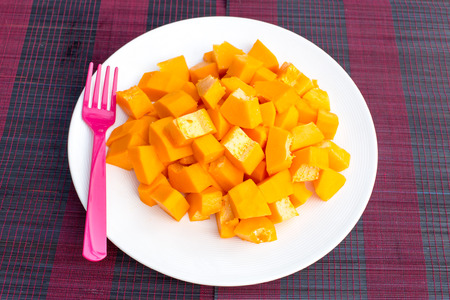Papaya fruit in dish on Wooden table photo