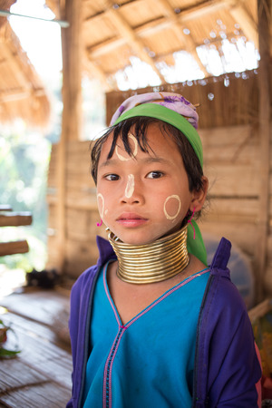 CHIANG MAI, THAILAND - JAN 31: Unidentified Karen tribe girl poses for the camera in Chiang Mai on January 31, 2014. The Karen people wear brass rings around their neck from as young as five years old.