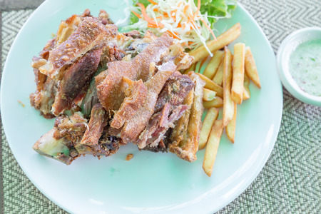 shank: Roasted pork shank with French fries