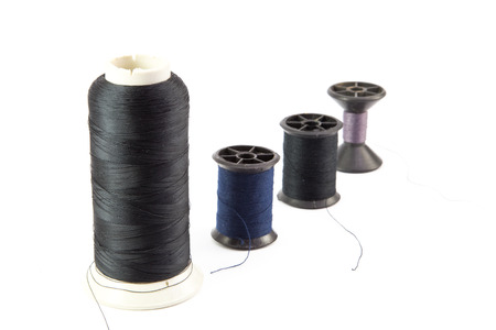 darn: multi-colored r threads for sewing on white background Stock Photo