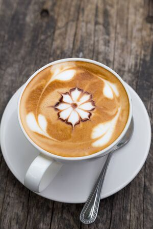 cappuccio: art latte coffee on white cup