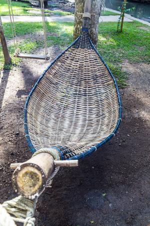 cane chair: Empty bamboo hammock in the garden