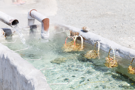 Boil the eggs in hot springs, Chiang Mai, Thailand. Stock Photo