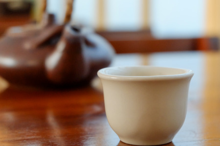 sparce: ceramic tea pot and cup on wood table Stock Photo