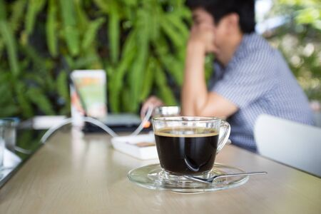 bussiness man: cup of coffee with man use laptop background