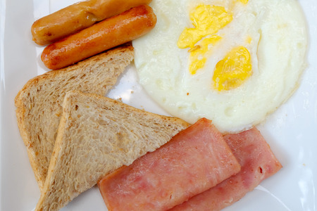 eggs and bacon: breakfast with fried eggs, bacon, sausages