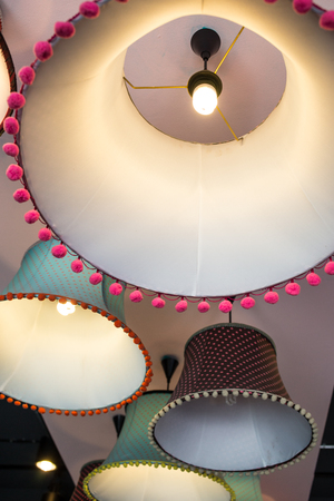 lampshades: round stylish lampshades hang from ceiling Stock Photo