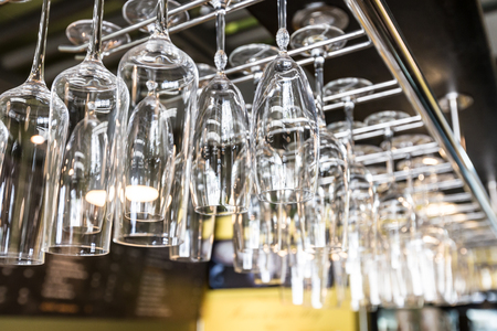 bar ware: Glasses hanging by metal bar rack
