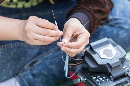 splice: fiber optic fusion splicer in field Stock Photo