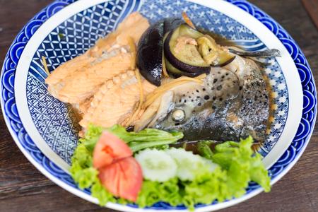 flesh eating animal: salmon head with sweet sauce,japanese food