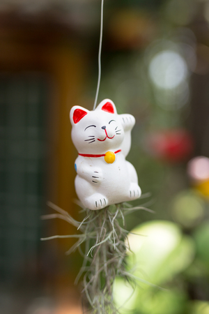 hung: Ceramic doll hung swing in the garden