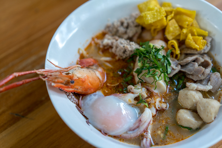A Big bowl of spicy seafood noodles soup  and boiled egg  Traditional Thai food