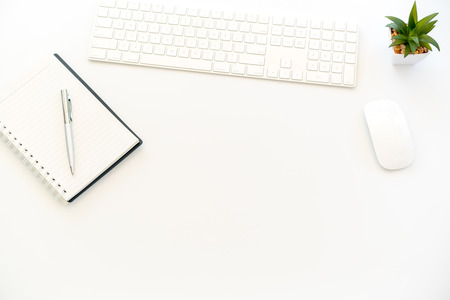 White Workspace with keyboard And notebook
