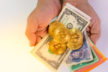 bitcoin and money holder with hand