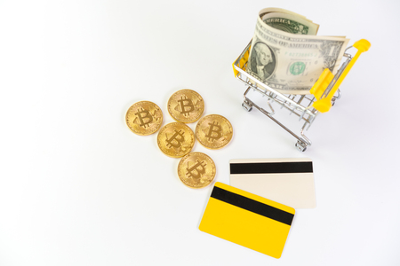 bitcoin and shopping cart on white background