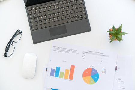 White Workspace with laptop  and chart Фото со стока