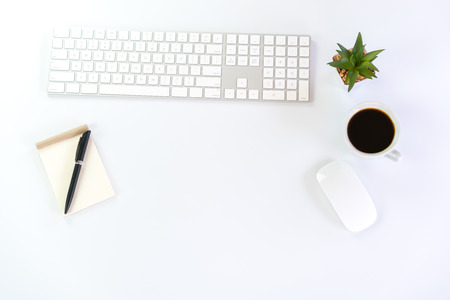 White Workspace with keyboard  mouse And notebook