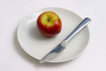 frontal views: apple and knife Stock Photo