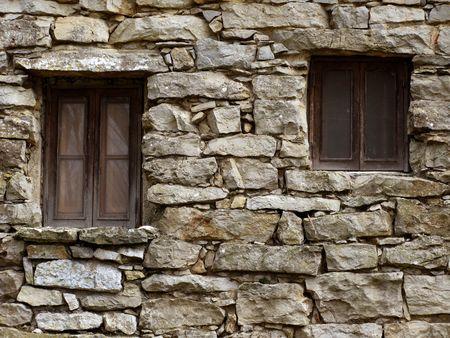 inorganic: Abandoned house - Stone wall with two windows Stock Photo