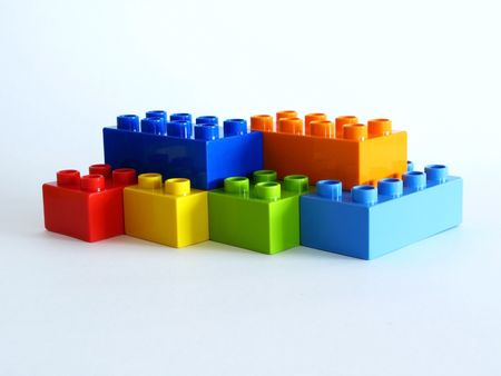 Photo of colorful building blocks on white background photo