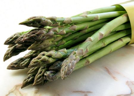 A bunch of fresh asparagus isolated on white background