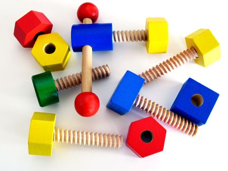 Colored wooden toys - yellow, red, blue and green screws photo