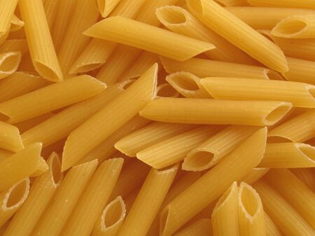 Background with a close up of the italian noodles penne photo