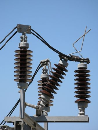 insulators: ceramic insulators on high tension power lines near a railway