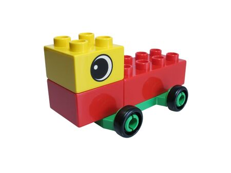 Car made with colorful bricks on a over white background photo