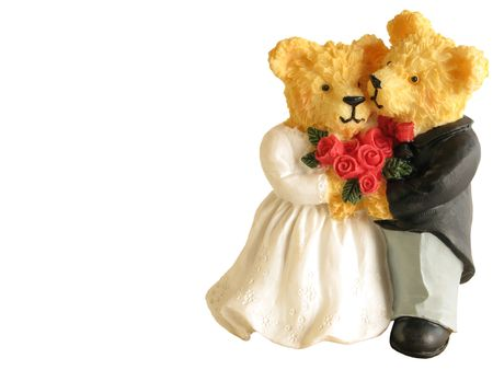 A couple of teddies dressed as bride and groom photo