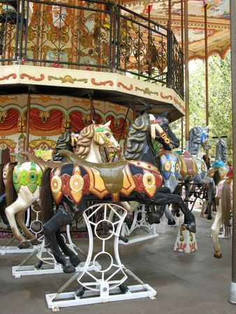 Detail of a colorful merry-go-round: Several wooden horses Stock Photo - 1769781