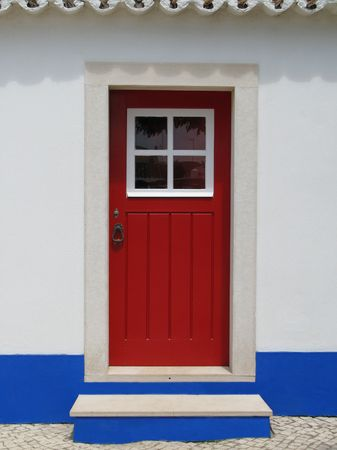 alentejo: Red door of a house in a small village: Alentejo - Portugal Stock Photo