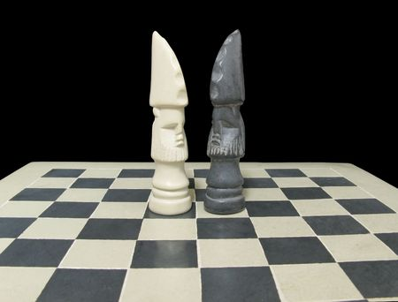 arranged: White and black king (face-to-face) on a chessboard isolated on a black background