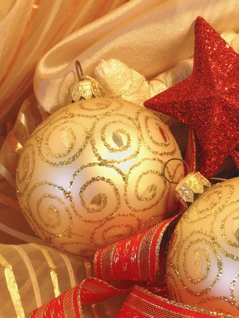 Christmas background with golden ball, stars and red ribbons photo