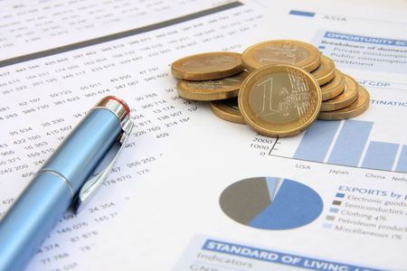 show bill: Business background: Financial reports, euro coins and a blue pen (focus on the coins)
