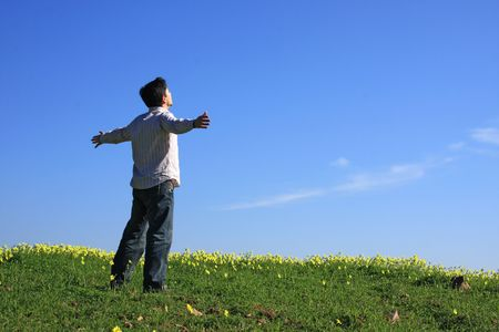 Young man looking to the sky with his arms outstretched Stock Photo - 2513636