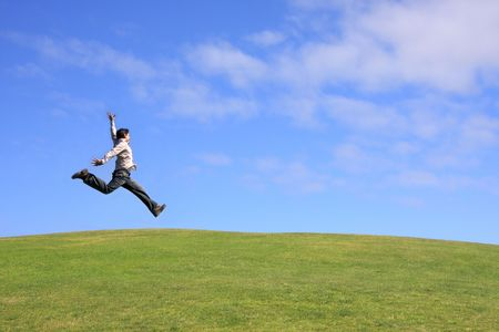 Happy man jumping on a beautiful landscape Stock Photo