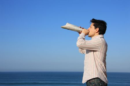 amplified: Young man speaking with a newspaper megaphone