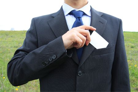 smartness: Businessman holding a blank card from his pocket Stock Photo