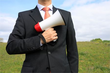 A business man holding a megaphone photo