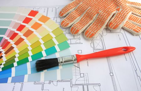 A color guide, a brush and gloves with a house plan on background Stock Photo - 2739406