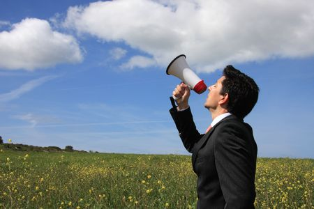 agitation: A business man speaking to god with a megaphone  Stock Photo