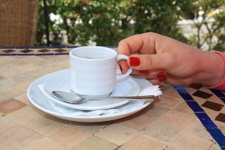 A female hand holding a cup of coffee Stock Photo - 3259429