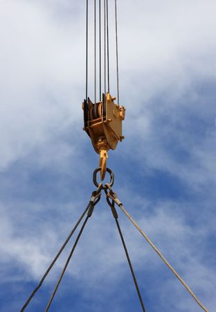 Close up of a crane hook lifting something photo